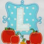 Choose your own letter to have appliqued on this adorable design.  Change fabric colors to make it for a boy. PA