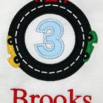 In the center of the race track, you can put either an applique letter or applique number.