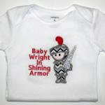Onesie/Applique Knight/Name Included in the price.  Additional Writing Extra
