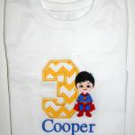 This superman hero is completely embroidered.  It is NOT an applique.  You can choose any applique number to add to it.  Please add $5.00 to the cost of this design due to the number of stitches involved.  Includes name too!