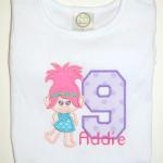 This design comes with the applique Troll and a name.  Extra to add an applique number.