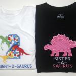 "The mini dinosaurs are totally embroidered.  The ""2"" shirt may be more $$ due to the amount of stitches.  PE"