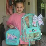 My sweet girl is showing off her new backpack, lunch tote and bow.  All personalized with her choice of the Narwhal design.  I don't think I had ever heard of one of these before.  She is so excited to start school and show off her new school supplies.