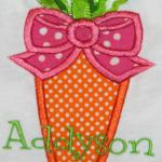 An adorable carrot applique with ribbons on top.  Great for Easter or all year.