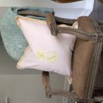 Beautiful pillows with embroidered pineapple top and three initials.